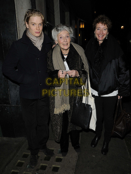 Freddie Fox, Phyllida Law & Emma Thompson.The 'One Night Only' charity event in aid of The Combined Theatrical Charities, The Ivy restaurant, West St., London, England..December 2nd, 2012.full length black jacket leggings collar brown bag purse smiling short cropped hair beige scarf mother mom um daughter family.CAP/CAN.©Can Nguyen/Capital Pictures.