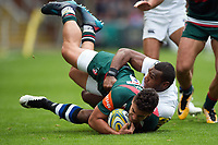 Matt Toomua of Leicester Tigers is tackled by Semesa Rokoduguni of Bath Rugby. Aviva Premiership match, between Leicester Tigers and Bath Rugby on September 3, 2017 at Welford Road in Leicester, England. Photo by: Patrick Khachfe / Onside Images