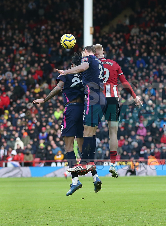 Oli McBurnie of Sheffield Utd and Simon Francis of Bournemouth during the Premier League match at Bramall Lane, Sheffield. Picture date: 9th February 2020. Picture credit should read: Chloe Hudson/Sportimage