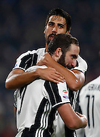 Calcio, Serie A: Juventus Stadium. Torino, Juventus Stadium, 29 ottobre 2016.<br /> Juventus&rsquo; Gonzalo Higuain, foreground, celebrates with teammate Sami Khedira after scoring the winning goal during the Italian Serie A football match between Juventus and Napoli at Turin's Juventus Stadium, 29 October 2016. Juventus won 2-1.<br /> UPDATE IMAGES PRESS/Isabella Bonotto