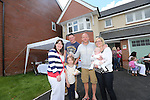 Redrow Homes Meet The Neighbours event at Parc Heol Gerrig, Merthyr Tydfil..Local residents Jemma Sawday, Paul Price, Chloe Price, Jamie Awford & Donna Awford holding baby Maddison..25.05.13.©Steve Pope