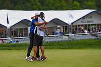 Brooks Koepka (USA) hugs his caddie as they celebrate winning the 2019 PGA Championship, Bethpage Black Golf Course, New York, New York,  USA. 5/19/2019.<br /> Picture: Golffile | Ken Murray<br /> <br /> <br /> All photo usage must carry mandatory copyright credit (© Golffile | Ken Murray)