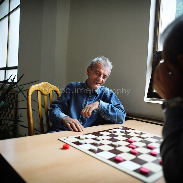 Playing chess in NKR is a national sport. Here a man playing with one of his friends at the House .of Chess in Stepanakert.