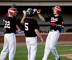 WATERTOWN,  CT-071018JS11-- Oakville's Matt McGrath (10), right, is congratulated by teammates Justin Guerrera (22) and Alan Stinson) after coming in to score on a two-RBI hit by Cam Defeo (3)  during their Zone 5 American Legion game against Naugatuck Tuesday at the Taft School in Watertown. <br />  Jim Shannon Republican American