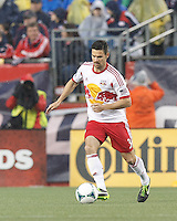 New York Red Bulls defender Heath Pearce (3) brings the ball forward. In a Major League Soccer (MLS) match, the New England Revolution (blue) tied New York Red Bulls (white), 1-1, at Gillette Stadium on May 11, 2013.