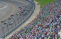 Jun. 22, 2008; Newton, IA, USA; IRL drivers Scott Dixon (10) and Helio Castroneves (3) lead the field on the first lap during the Iowa Corn Indy 250 at the Iowa Speedway. Mandatory Credit: Mark J. Rebilas-