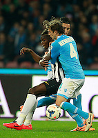 Calcio, Serie A: Napoli vs Juventus. Napoli, stadio San Paolo, 30 marzo 2014. <br /> Juventus midfielder Paul Pogba, of France, left, is challenged by Napoli forward Jose' Maria Callejon, of Spain, and defender Adriano Buss Henrique, of Brazil, foreground, during the Italian Serie A football match between Napoli and Juventus at Naples' San Paolo stadium, 30 March 2014. Napoli won 2-0.<br /> UPDATE IMAGES PRESS/Isabella Bonotto