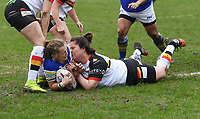 Picture by Anna Gowthorpe/SWpix.com - 15/04/2018 - Rugby League - Womens Super League - Bradford Bulls v Leeds Rhinos - Coral Windows Stadium, Bradford, England - Leeds Rhinos' Lois Forsell scores a try under pressure from Bradford Bulls' Debbie Smith
