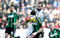 Calcio, Serie A: Sassuolo vs Juventus. Reggio Emilia, Mapei Stadium, 29 gennaio 2017. <br /> Sassuolo's Luca Antei, foreground, and Juventus&rsquo; Gonzalo Higuain fight for the ball during the Italian Serie A football match between Sassuolo and Juventus at Reggio Emilia's Mapei stadium, 29 January 2017.<br /> UPDATE IMAGES PRESS/Isabella Bonotto