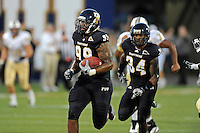 17 September 2011:  FIU defensive lineman Isame Faciane (99) returns a fumble recovery for a touchdown at the end of the first half to tie the game as the FIU Golden Panthers defeated the University of Central Florida Golden Knights, 17-10, at FIU Stadium in Miami, Florida.