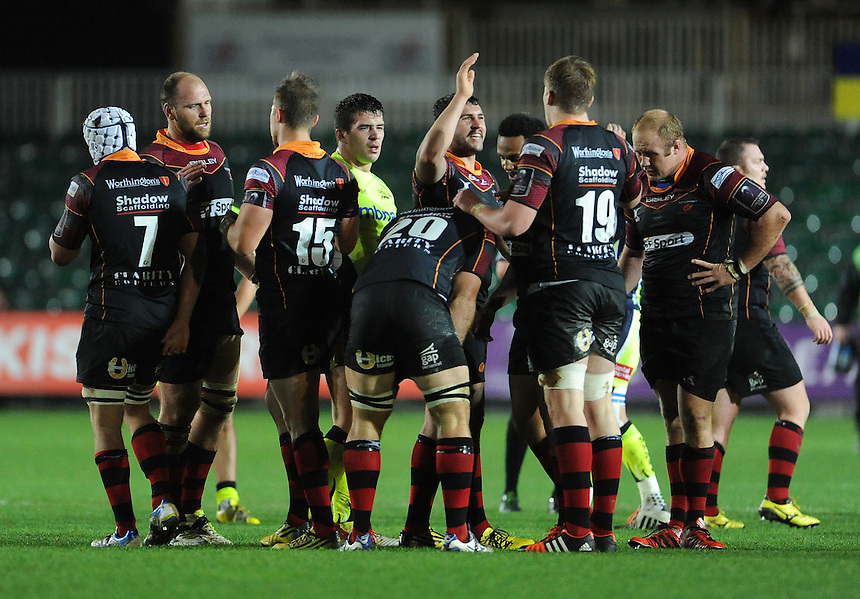 Newport Gwent Dragons players celebrate at the final whistle <br /> <br /> Photographer Ian Cook/CameraSport<br /> <br /> Rugby Union - European Rugby Challenge Cup Pool 2 - Newport Gwent Dragons v Sale Sharks - Sunday 15th November 2015 - Rodney Parade - Newport<br /> <br /> &copy; CameraSport - 43 Linden Ave. Countesthorpe. Leicester. England. LE8 5PG - Tel: +44 (0) 116 277 4147 - admin@camerasport.com - www.camerasport.com