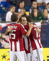 Chivas USA midfielder Nick LaBrocca (10) celebrates his goal with teammates. In a Major League Soccer (MLS) match, Chivas USA defeated the New England Revolution, 3-2, at Gillette Stadium on August 6, 2011.