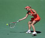 Caroline Wozniacki battles at the Sony Ericsson Open in Key Biscayne, Florida on March 29, 2012