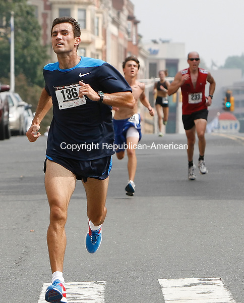 WATERBURY, CT, 09/14/08- 091308BZ12- Andy Marcu, of Bridgeport, heads to the line on Grand Street in Waterbury during the 3rd annual Bob Veillette 5K Road Race and Walk and Kids Fun Run Sunday afternoon. <br /> Jamison C. Bazinet Republican-American