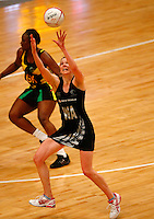 17.1.2014 New Zealand's Camilla Lees in action against Jamaica during their netball test match in London, England. Mandatory Photo Credit (Pic: Tim Hales). ©Michael Bradley Photography.