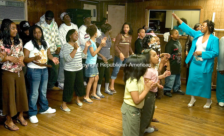 WATERBURY, CT--08 APRIL 2007--040807JS16-Event Chariperson, Daughter Vernecia Gatling, right, leads participants in a final song during the Goodwill Lodge #1325 and Clock City Temple #895's Beauty and Talent Department Annual Easter Fashion and Talent Show Sunday at the Goodwill Lodge in Waterbury.<br /> Jim Shannon / Republican-American