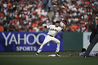 SAN FRANCISCO, CA - APRIL 3:  Kelby Tomlinson #37 of the San Francisco Giants makes a play at second base against the Seattle Mariners during the game at AT&T Park on Tuesday, April 3, 2018 in San Francisco, California. (Photo by Brad Mangin)