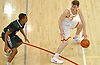 Robert Connors #15 of Chaminade, right, looks to get to the hoop during a CHSAA varsity boys basketball game against Holy Trinity at Chaminade High School in Mineola on Friday, Feb. 16, 2018. Chaminade won by a score of 79-61.