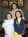 Leah Donnelly Quinn who received her first holy communion in St Mary's church pictured with mam Karen and sister Casey. Photo:Colin Bell/pressphotos.ie