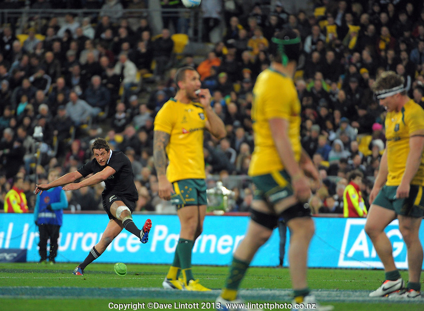 Tom Taylor kicks for goal during the Rugby Championship international rugby Bledisloe Cup test match between All Blacks and Australia at Westpac Stadium, Wellington, New Zealand on Saturday, 24 August 2013. Photo: Dave Lintott / lintottphoto.co.nz