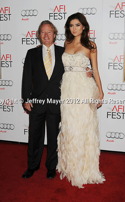 HOLLYWOOD, CA - NOVEMBER 01: John Savage and Blanca Blanco arrive at the opening night gala premiere of 'Hitchcock' during the 2012 AFI FEST at Grauman's Chinese Theatre on November 1, 2012 in Hollywood, California.