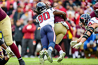 Landover, MD - November 18, 2018: Washington Redskins quarterback Colt McCoy (12) is sacked by Houston Texans outside linebacker Jadeveon Clowney (90) during second half action of game between the Houston Texans and the Washington Redskins at FedEx Field in Landover, MD. The Texans defeated the Redskins 23-21. (Photo by Phillip Peters/Media Images International)