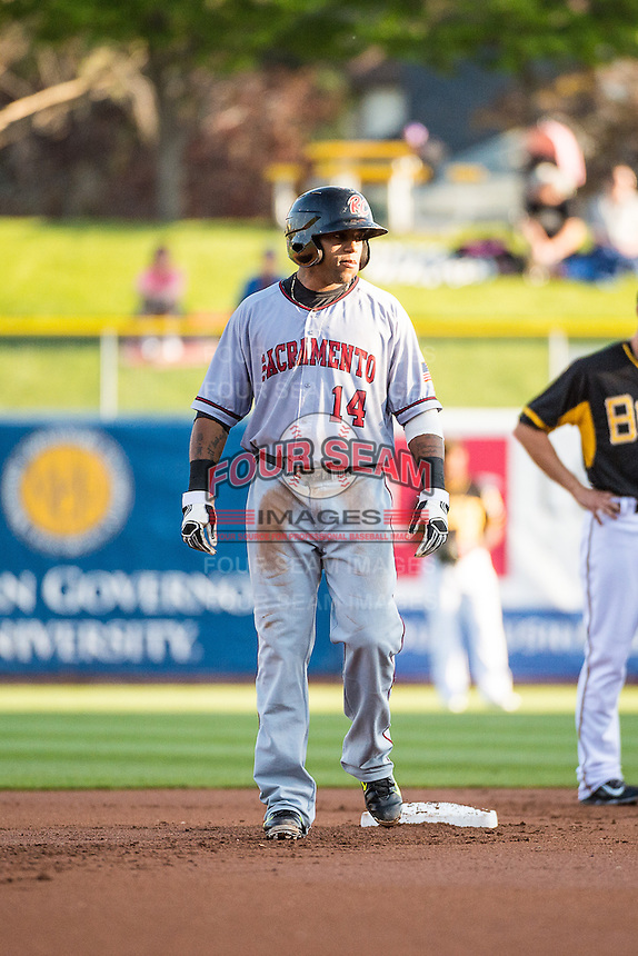 Darren Ford (14) of the Sacramento River Cats during the game against the Salt Lake Bees in Pacific Coast League action at Smith's Ballpark on April 20, 2015 in Salt Lake City, Utah.  (Stephen Smith/Four Seam Images)