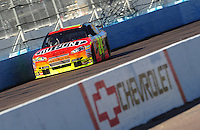 Apr 17, 2009; Avondale, AZ, USA; NASCAR Sprint Cup Series driver Jeff Gordon drives past a Chevrolet sign during qualifying for the Subway Fresh Fit 500 at Phoenix International Raceway. Mandatory Credit: Mark J. Rebilas-