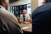 United States President Barack Obama (C) has lunch with with winners of a campaign contest, at Scion Restaurant in Washington DC, USA, on 06 January 2012..Credit: Michael Reynolds / Pool via CNP