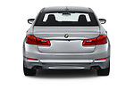 Straight rear view of a 2018 BMW 5 Series 540i Sport Line 4 Door Sedan stock images