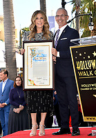 LOS ANGELES, CA. March 29, 2019: Rita Wilson & Mitch O'Farrell at the Hollywood Walk of Fame Star Ceremony honoring actress Rita Wilson.<br /> Pictures: Paul Smith/Featureflash