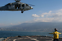 PORT-AU-PRINCE, Haiti – A Navy helicopter from the USS Vincent delivers humanitarian supplies to the Coast Guard Cutter Mohawk off the coast of Port-au-prince Friday, Jan. 15, 2010. The supplies were then taken to the Haitian coast guard base at Killick, Haiti. U.S. Coast Guard photo.