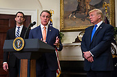 "United States Senator David Perdue (Republican of Georgia) makes an announcement on the introduction of the Reforming American Immigration for a Strong Economy (RAISE) Act in the Roosevelt Room at the White House in Washington, D.C., U.S., on Wednesday, August 2, 2017. The act aims to overhaul U.S. immigration by moving towards a ""merit-based"" system.  Also pictured are US Senator Tom Cotton, a Republican from Arkansas, left, and US President Donald J. Trump, right. <br /> Credit: Zach Gibson / Pool via CNP"
