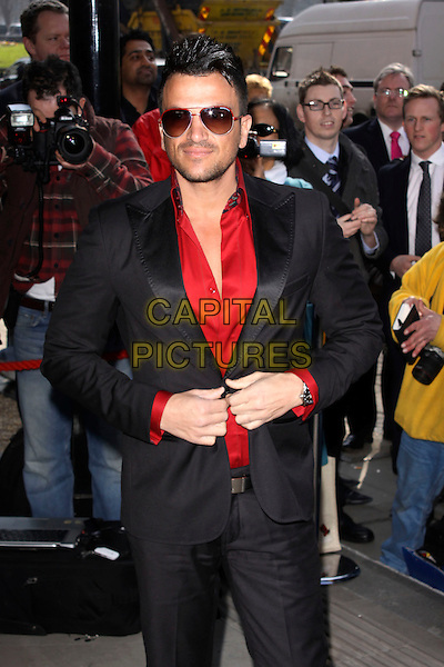 PETER ANDRE .Attending the TRIC (Television and Radio Industries Club) Awards at Grosvenor House, London, England, UK, March 8th 2011..outside  arrivals half  length aviators stubble facial hair  red shirt sunglasses shades black suit hands .CAP/AH.©Adam Houghton/Capital Pictures.