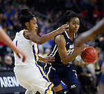 SIOUX FALLS, SD: MARCH 5: Jordan Gilbert #22 of Oral Roberts drives on Alexis Alexander #1 of South Dakota State during the Summit League Basketball Championship on March 5, 2017 at the Denny Sanford Premier Center in Sioux Falls, SD. (Photo by Dick Carlson/Inertia)