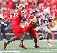*Ohio State Buckeyes running back Jalin Marshall (17) pushes Maryland Terrapins defensive back William Likely (4) out of the way as he gains yardage in second half action at Byrd Stadium on October 4, 2014.  (Chris Russell/Dispatch Photo)