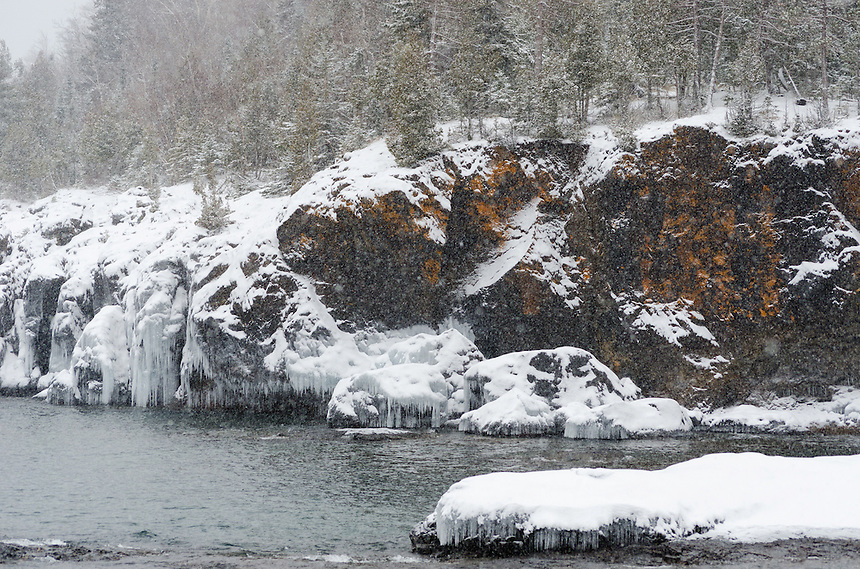 A wintery scene along the rocky Lake Superior shoreline. Marquette, MI