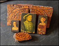BNPS.co.uk (01202 558833)<br /> Pic: PhilYeomans/BNPS<br /> <br /> The Binney families minature paintings, after Holbein, of Anne Bolyn, King Henry, and Jane Seymour, with unearthed Tudor tiles on which they may have walked.<br /> <br /> Historic Wolf Hall, home to the Seymour family and star of Hilary Mantel's famous trilogy on Henry VIII th, has finally been definitively located after new discoveries around the much smaller ramshackle house that remains today. <br /> <br /> Despite it's fame, nobody really knew where the enormous Tudor pile actually was, or what it looked like, due to its very short but very influential existance in the middle of the tumultuous 16th century.<br /> <br /> Built with a million pound loan (&pound;2,400) from King Henry in 1531, brokered by Thomas Cromwell, the huge house was rapidly brick built in time for the King's pivotal visit with the court and troublesome wife Anne Boleyn in 1535, at which point Sir John Seymour's daughter Jane caught his eye, within a year Anne was dead and Jane, and the rest of the Seymour clan were in.<br /> <br /> They benefitted massively from Royal patronage and the dissolution of the monastries, but it all went wrong when Henry died and the brothers fell out and were later executed in a spectacular fall from power only 21 years after the house was built.<br /> <br /> Historian Graham Bathe and his team have now uncovered part of the outline of the original building, as well as the extensive Tudor brick sewer system that proves the huge scale of the 16th century mansion.