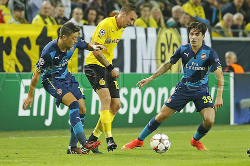 16.09.2014. Dortmund, Germany. Champions League group stages; Borussia Dortmund, versus Arsenal. Signal-Iduna-Park-Stadion Dortmund.  Kevin GROSSKREUTZ, BVB challanged by Mesut OEZIL, Arsenal