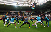 Swansea City players warm up prior to the Premier League match between Swansea City and Newcastle United at The Liberty Stadium, Swansea, Wales, UK. Sunday 10 September 2017