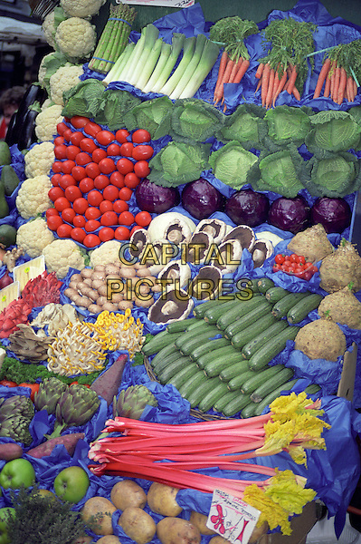 Vegetables on display on a market stall, England
