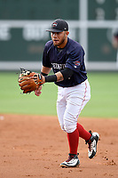 Second baseman Everlouis Lozada (4) of the Greenville Drive plays defense in Game 1 of a doubleheader against the Hickory Crawdads on Wednesday, July 25, 2018, at Fluor Field at the West End in Greenville, South Carolina. Greenville won, 4-1. (Tom Priddy/Four Seam Images)