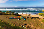 Windsurfers hanging out on shore at Ho'okipa Beach Park, Paia, Maui, Hawaii, USA