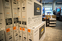 Boxes of Sony 4K Ultra High Definition televisions waiting to be sold in a Best Buy electronics store in New York on Sunday, November 29, 2015. The cost of 4K televisions has come down precipitously this year making them the great hope of retailers as the hot holiday item. (© Richard B. Levine)