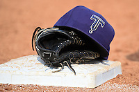 Tulsa Drillers hat and glove sitting on first base in between innings during the first game of a doubleheader against the Frisco Rough Riders on May 29, 2014 at ONEOK Field in Tulsa, Oklahoma.  Frisco defeated Tulsa 13-4.  (Mike Janes/Four Seam Images)
