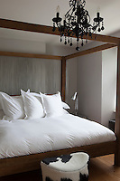 Extra large custom made four poster bed in a guest bedroom in Whitehouse, a guest house in Chillington, Devon