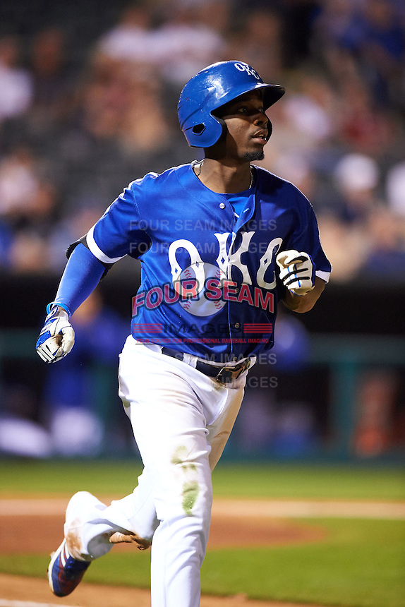 Oklahoma City Dodgers second baseman Darnell Sweeney (9) runs to first during a game against the Fresno Grizzles on June 1, 2015 at Chickasaw Bricktown Ballpark in Oklahoma City, Oklahoma.  Fresno defeated Oklahoma City 14-1.  (Mike Janes/Four Seam Images)