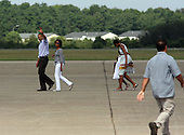 Cape Cod, MA - August 23, 2009 -- United States President Barack Obama, accompanied by his oldest daughter Malia, 11, followed by his wife Michelle and daughter Sasha, 8, leave Air Force One after the First Family landed at Cape Cod Coast Guard Air Station on Cape Cod, Massachusetts Sunday, August 23, 2009. The First Family then boarded a US Marine helicopeter for their week-long vacation on Martha's Vineyard, Massachusetts..Credit: Vincent DeWitt - Pool via CNP