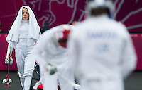 12 AUG 2012 - LONDON, GBR - Anastasiya Prokopenko (BLR) (left) of Belarus prepares for her next match during the women's London 2012 Olympic Games Modern Pentathlon fencing at The Copper Box in the Olympic Park, in Stratford, London, Great Britain .(PHOTO (C) 2012 NIGEL FARROW)