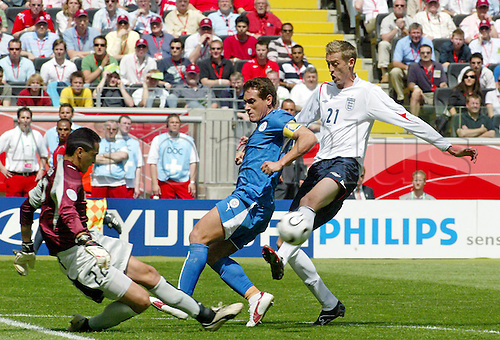 10 June 2006: England striker Peter Crouch shoots during the World Cup Group B match between England and Paraguay played in Frankfurt. England won the game 1-0. Photo: actionplus....060610 soccer football fan man men male shot shoot block goalkeeper keeper.